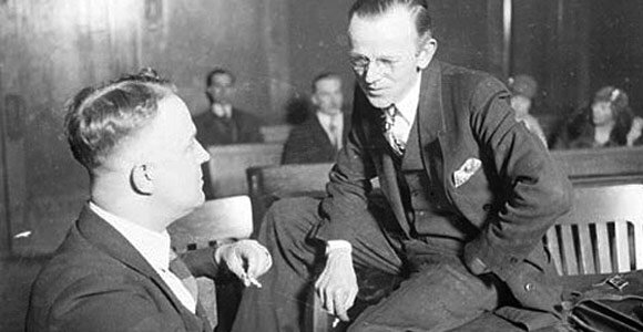 John-P.-Ryan-sitting-on-a-table-in-a-courtroom-talking-to-an-unidentified-man-1928